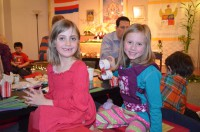 Two young participants having fun and making friends at the Children's Day Celebration at SMCD on December 21, 2012.